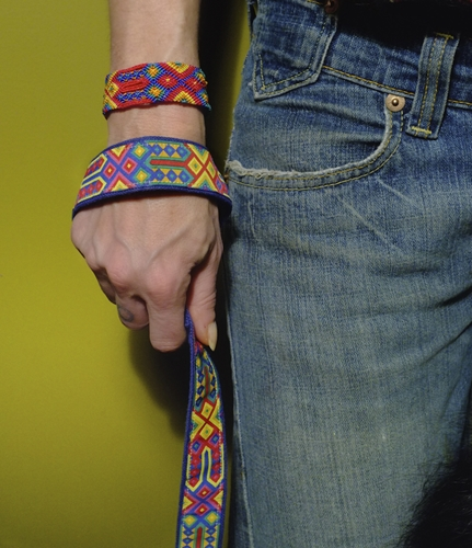 person wearing speck friendship bracelet and holding matching hemp dog collar